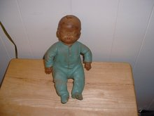 Vintage black baby boy squeeze doll in pajamas with drop seat back
