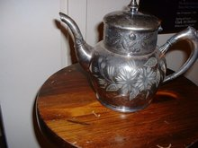 1890's Rogers Bros quadruple silverplate ornate floral design teapot or coffeepot