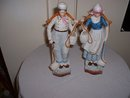 1930's W K C Solingen Germany matching  figurines of a boy and girl carrying water buckets