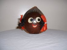 1950's black head on a coconut bank, very