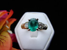 Lady's 18K Oval Emerald Ring