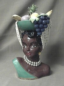 Island Lady with basket of fruit on her head