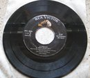 Elvis Presley Double 45 Record: Side 1, Love Me Tender-Let Me 2, Poor Boy-We're Gonna Move