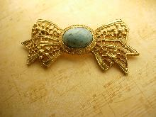 Large Vintage Turquoise cabochon Bow Brooch Ornate etchings