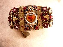 MIchal Negrin bracelet Victorian  SIgned wide brass and floral with pearls