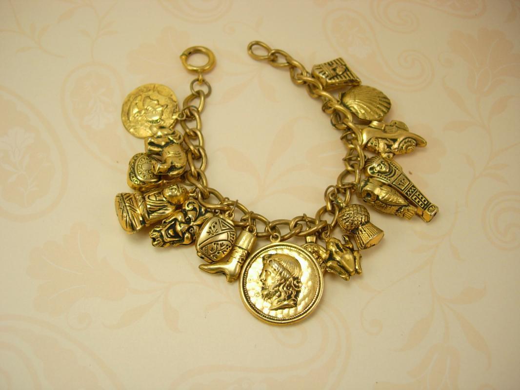 Vintage Devil head Egyptian Charm bracelet mummy coin Buddah 16 charms