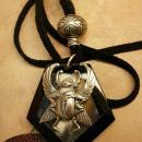 Onyx scarab talisman necklace with eerie agate that catches the moon