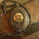 Vintage gunmetal moon locket Whimsical face in mixed metals
