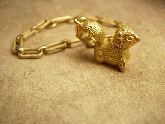 Vintage skunk  perfume locket charm bracelet Little stinkers Charles Alton