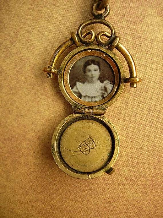 ANtique watch fob locket with little girl photo Flip fob ornate metal work