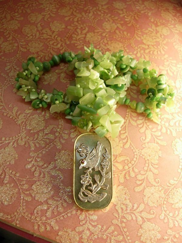 Chunky jade flowered necklace with jeweled bird pendant