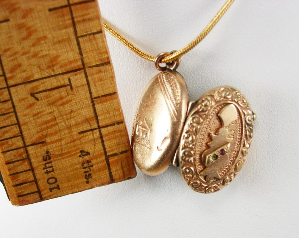 Antique Locket Victorian rose gold filled with garnet and fancy relief necklace