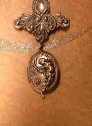 Vintage Art Nouveau winged Nude Cherub Locket brooch with old photo