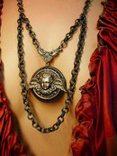 Gothic Winged Cherub locket necklace dripping in gunmetal chain