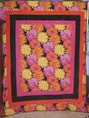 Throw Twin Quilt Dahlias 67 x 80 oranges pinks yellows blacks