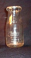 Queen City embossed half-pint milk bottle