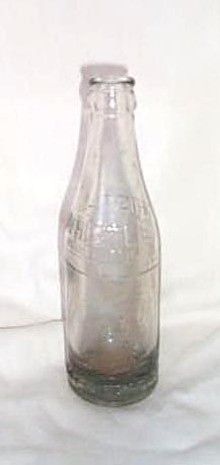 Whistle Bottling Company embossed soda pop bottle