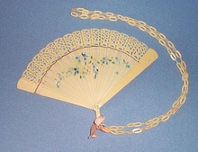Celluloid ladies fan with floral decoration and chain