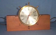 O. B. McClintock Company brass ship's wheel clock