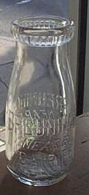 Breuninger Nearby Dairies embossed half-pint milk bottle