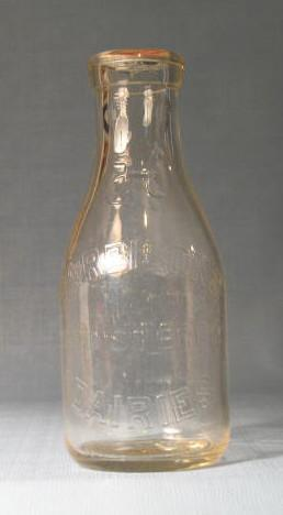 Harbisons Registered Dairies Philadelphia PA embossed quart milk bottle