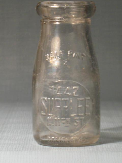 Supplee 1442 N. 11th St. Philadelphia PA embossed half-pint milk bottle