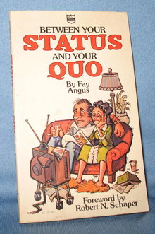 Between Your Status and Your Quo by Fay Angus