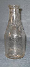 Flora Pure Milk Co., Flora IL embossed quart milk bottle