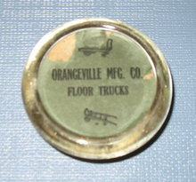 Orangeville Mfg. Co. Floor Trucks glass paperweight