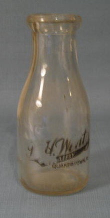 J. H. Wentz, Quakertown PA black pyro pint milk bottle