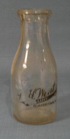 J. H. Wentz, Quakertown PA black pyro pint milk bottle