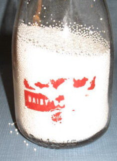 Supplee Sealtest Dairy quart milk bottle with red pyro