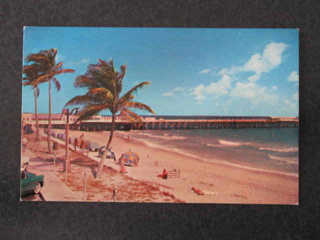 View of the beautiful beach and pier at Palm Beach, Florida postcard