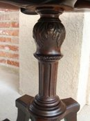 Antique English Carved Mahogany Round Rolling Table