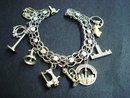 SPECTACULAR STERLING SILVER BRACELET 10 UNIQUE LARGE CHARMS