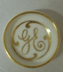 TINY LIMOGES OPEN SALT DISH MONOGRAM GE