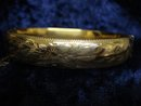 OLD HINGED BANGLE BRACELET - FLORAL DETAIL