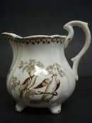 OLD BROWN TRANSFERWARE JUG