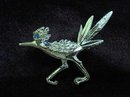 PRETTY SILVER TONE BROOCH - PIN - ROAD RUNNER
