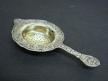 ORNATE TEA STRAINER FLORAL  EMBOSSING
