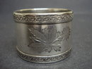 ANTIQUE NAPKING RING - FLORAL ENGRAVINGS