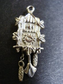 Sterling Charm Cuckoo Clock moving weights