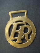 Antique Horse Brass E R