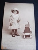 Real Photo Postcard Tiny Girl w/ Windmill Toy