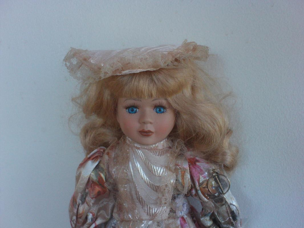 16 inch tall Bisque porcelain doll