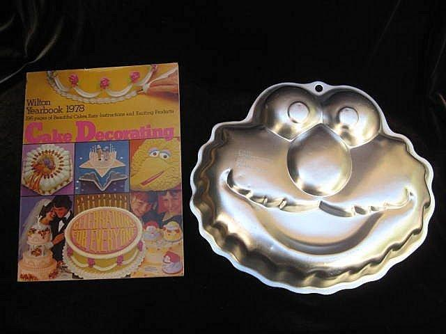 Lot of 6 Sesame Street Cookie Cutters, Wilton Elmo Cake Pan & Wilton 1977 Yearbook