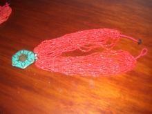 A ladies Multi strand Red Natural Coral and Turquoise Necklass