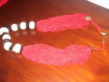 A ladies Multi strand Red Natural Coral and Wood Necklace