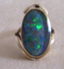 Ladys Firey Opal Doublet Ring- Marked 9ct.- Weighs 5.6 Grams