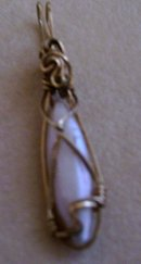 A Ladys Pearl Pendant wrapped in 14K Gold